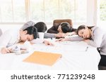 Small photo of Businesspeople sleep in the conference room after work all night.