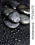 Beads Of Dew On Wet Black Stones