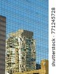 sky reflected in tower buildings | Shutterstock . vector #771245728