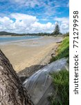 Small photo of Looking through to a view of Ngunguru Harbour beach and river estuary at low tide in summer - Northland, New Zealand, NZ