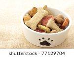 Stock photo dog treats in bowl 77129704