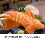 closeup slice of salmon sashimi ... | Shutterstock . vector #771302383