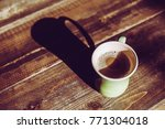 mug cup on the table | Shutterstock . vector #771304018