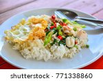 spicy fried seafood with basil... | Shutterstock . vector #771338860