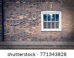 white wooden sash window on a... | Shutterstock . vector #771343828