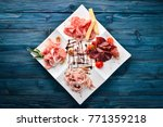 plateau of meat delicacies.... | Shutterstock . vector #771359218