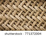 Small photo of Weave texture or weave pattern background in macro view. Weaves patten classic retro background for design.