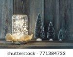 christmas light in a glass jar... | Shutterstock . vector #771384733