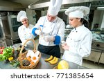 chef and kitchen staff. teamwork | Shutterstock . vector #771385654