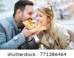 couple eating pizza snack... | Shutterstock . vector #771386464