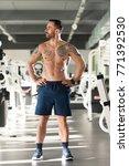 handsome young man standing...   Shutterstock . vector #771392530