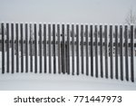 wooden fence in the snow | Shutterstock . vector #771447973