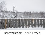wooden fence in the snow | Shutterstock . vector #771447976