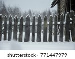 wooden fence in the snow | Shutterstock . vector #771447979
