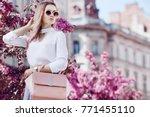 outdoor portrait of young... | Shutterstock . vector #771455110