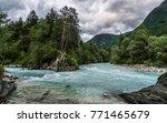 the river soca in slovenia on a ... | Shutterstock . vector #771465679