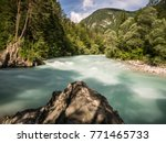 the river soca in slovenia on a ... | Shutterstock . vector #771465733
