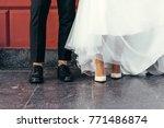 feet of the newlyweds. feet... | Shutterstock . vector #771486874