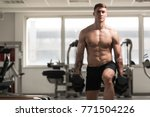 young man working out legs with ...   Shutterstock . vector #771504226
