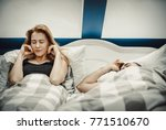 snoring man in bed with wife | Shutterstock . vector #771510670