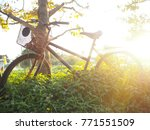 old vintage bicycle in the... | Shutterstock . vector #771551509