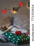 gifts on the bed. christmas or... | Shutterstock . vector #771553414