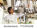 chef in the kitchen taking a... | Shutterstock . vector #771554248