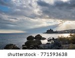 Small photo of Castle of Aci Catello with cloudy sky - Sicily