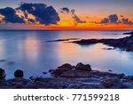 beautiful sunrise on rocky... | Shutterstock . vector #771599218