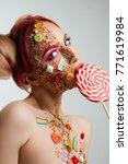 slim nude girl sucking a... | Shutterstock . vector #771619984