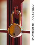 Small photo of India, Pondicherry - December 06, 2017: At Home - Reckon Heavier lock is hanging in outside grill door in selective focus