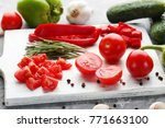 sliced tomatoes and red peppers ... | Shutterstock . vector #771663100