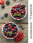 ripe and sweet berries in bowls ... | Shutterstock . vector #771663130