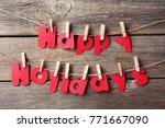 inscription happy holiday... | Shutterstock . vector #771667090