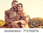 young couple walk in the autumn ... | Shutterstock . vector #771702076