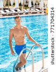 Small photo of Young person in the swimming pool leisure concept