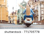 young couple on scooter travel... | Shutterstock . vector #771705778