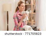 woman doing home choirs... | Shutterstock . vector #771705823