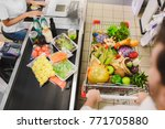 man buying food products in the ... | Shutterstock . vector #771705880