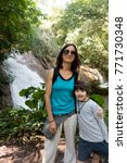 Small photo of AGUA AZUL WATERFALLS, MEXICO - JANUARY 30, 2015: MOTHER AND SON AT FAMOUS AGUA AZUL WATERFALLS.