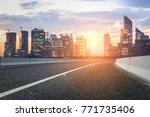 asphalt highway and modern city ...   Shutterstock . vector #771735406