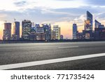 asphalt highway and modern city ... | Shutterstock . vector #771735424