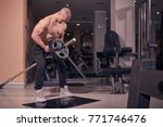 one bodybuilder  t bar row  gym ... | Shutterstock . vector #771746476