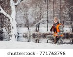 hunter in camouflage with rifle ... | Shutterstock . vector #771763798
