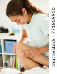 medical massage at the leg in a ... | Shutterstock . vector #771809950