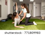 physical therapist assisting... | Shutterstock . vector #771809983