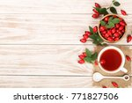 tea with rose hips and honey on ... | Shutterstock . vector #771827506