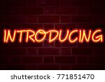 introducing neon sign on brick... | Shutterstock . vector #771851470