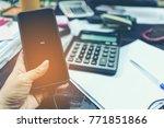 female's hand holding mobile... | Shutterstock . vector #771851866