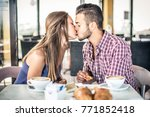 couple doing breakfast in a bar ... | Shutterstock . vector #771852418